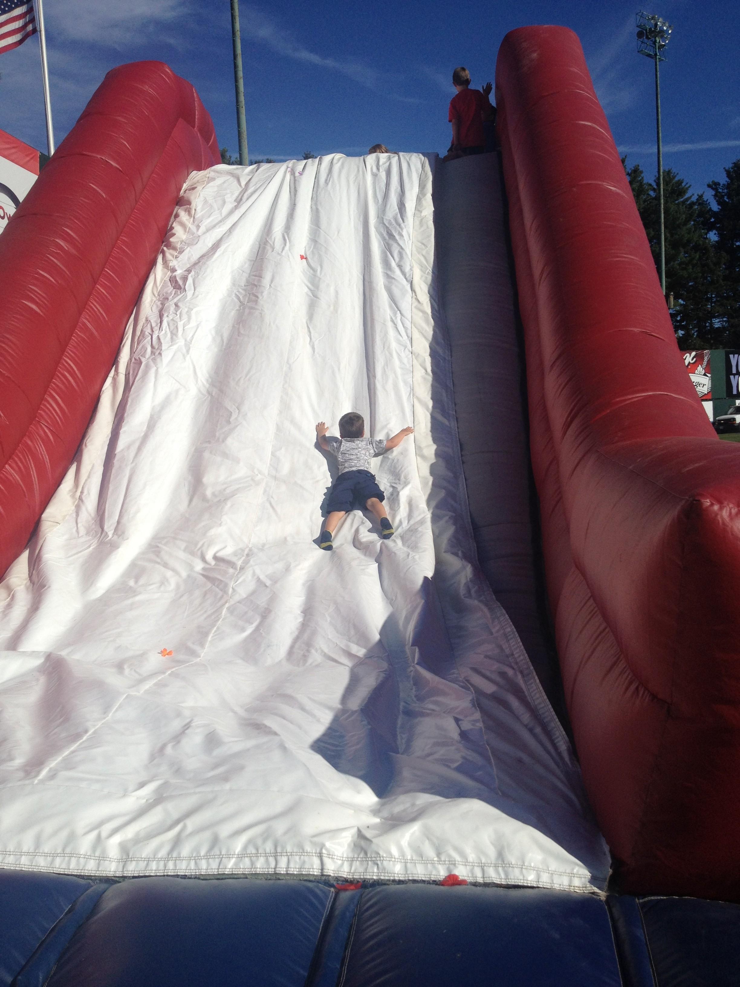 Patrick, taking full advantage of the bouncy-house slide.
